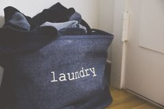 A laundry basket in the living room stock images