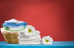 Laundry Basket with towels. Colorful basket laundry towels colors background nobody royalty free stock photos