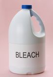 Laundry bleach. Closeup on bottle of laundry bleack, pink background Royalty Free Stock Photo