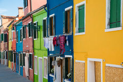 Laundry on Blue Home in Burano Stock Photos