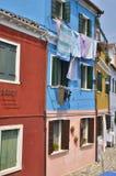 Laundry on blue house Stock Photography