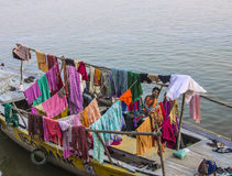 Laundry boat in Varanasi. A boat with colorful laundry, hung up to dry, on the holy river ganges Stock Photography