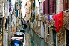Laundry and Boats on Venetian Canal Stock Image