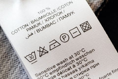 Laundry care label. Clothing labels with laundry care symbols closu-up royalty free stock photo