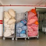 Laundry carts. Bags with dirty sheets at laundry carts Stock Photos