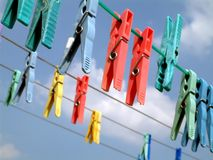 Laundry Clips. Clips on Plastic Wire Royalty Free Stock Photo