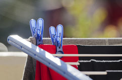 Laundry clips and clothing Royalty Free Stock Images