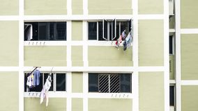 Laundry clothes hanging drying  on window building Royalty Free Stock Photography