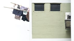 Laundry clothes hanging drying  on window building Stock Images