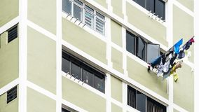 Laundry clothes hanging drying  on window building Stock Photos