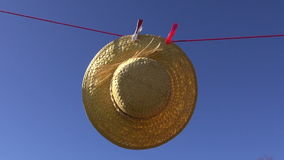 Laundry clothes line with woman straw summer hat in wind stock video