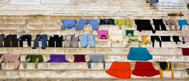 Laundry. Colorful laundry spread out on the holy ghats of Varanasi Royalty Free Stock Photos