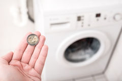Laundry costs Stock Image