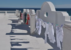 Laundry day. Laundry hanging on rooftop with ocean and sky in the background stock photos