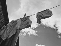 Laundry day. Clothes being hung on the laundry line Stock Photos
