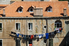 Laundry Day in Dubrovnik. A clothesline in front of a typical house in the old city of Dubrovnik royalty free stock photos