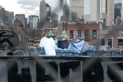 Laundry day in New York City, clothes drying on a Manhattan rooftop among graffiti and skyscrapers royalty free stock photos