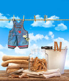Laundry day with towels, clothespins on table Royalty Free Stock Photo