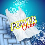 Laundry detergent with close up that cleans dirt in clothing, light blue background Stock Photography