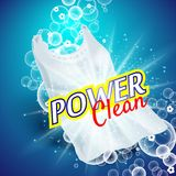 Laundry detergent with close up that cleans dirt in clothing, light blue background Stock Photos