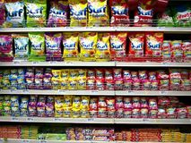 Laundry detergent soaps and other fabric washing products on display at a grocery store ready to be picked up by customers. stock image