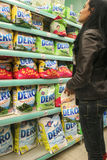 Laundry Detergents Materials in a supermarket. Bucharest, Romania, 17 January, 2017: A woman is looking at detergents in a supermarket in Bucharest Stock Photography