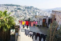 Laundry dries outdoor on a roof of house, located outside of Jer Stock Photo