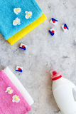 Laundry. Dry and liquid detergents near clean towel on grey stone background top view copyspace Royalty Free Stock Image