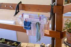 Laundry on the dryer in the garden.  stock photography