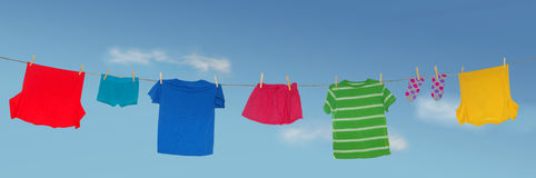 Laundry drying. Clean laundry drying outside on line Royalty Free Stock Photos