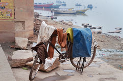 Laundry drying on bicycle near Ganga river in Harishchandra Ghat. Varanasi Royalty Free Stock Images