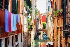 Laundry drying on clothesline above canal of Venice Royalty Free Stock Image