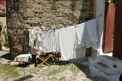 Laundry drying on the clothesline, Rhodes old town stock photos