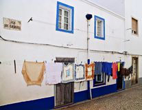 Laundry drying on the clothesline on a street in Portugal Stock Images