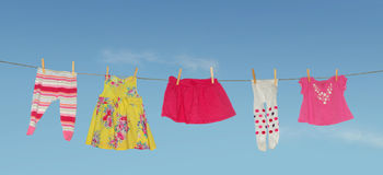 Laundry drying girl. Clean laundry drying outside on line Stock Photo