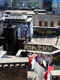 Laundry drying on  graffiti NY rooftop Royalty Free Stock Images