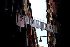 Laundry drying and hanging out on clotheslines stock images