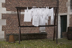 Laundry drying on medieval way Stock Photos