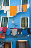 Laundry hanging outside a blue house, Burano, Italy Stock Photo