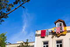 Laundry drying outside a house Royalty Free Stock Image