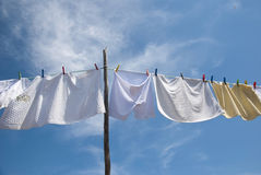 Laundry drying on the rope outside Royalty Free Stock Photos