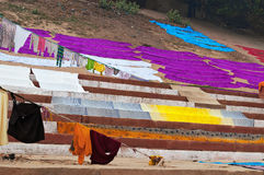 Laundry drying on the steps of ghat near Ganga river. Varanasi Stock Photo