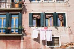 Laundry Drying Under Windows in Venice Stock Photos