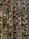 Laundry drying at windows of Chinese residential building Royalty Free Stock Photo