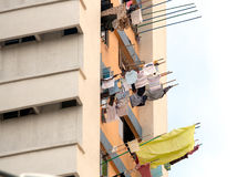 Laundry drying from windows, Singapore Stock Images