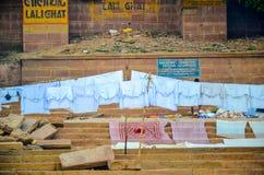 Laundry on Ganga riverbanks, Varanasi, Rajasthan, India. Laundry drying by the ghats of Varanasi Stock Image