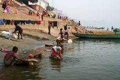 Laundry at the Ganges river. Every morning people do their laundry at the banks of the Ganges river in Varanasi, India stock photography