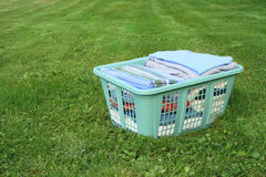 Laundry in hamper. Neatly folded laundry in plastic laundry hamper on lawn royalty free stock photos