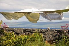 Laundry hang to dry in Aran islands, Ireland. Landscape with laundry hang to dry in Inisheer village in Aran islands, Ireland Royalty Free Stock Photos