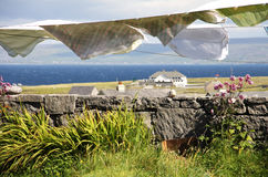 Laundry hang to dry in Aran islands, Ireland. Landscape with laundry hang to dry in Inisheer village in Aran islands, Ireland Stock Images